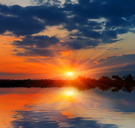 Nice sunset over lake Stock Photo - 13762966