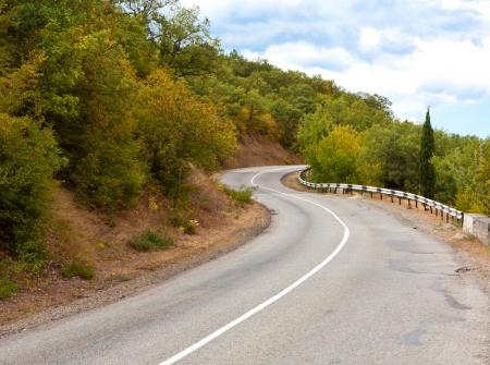 Mountain road turn in autumn time photo