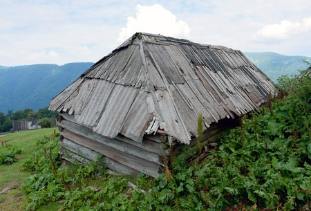 old wooden building in mountains photo