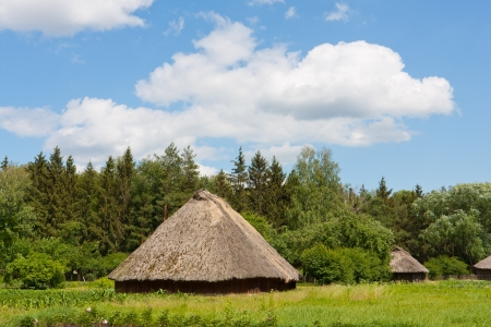 Ancient traditional ukrainian rural houses with a straw roof