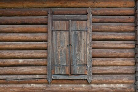closed window on rural wooden house photo