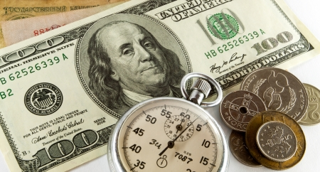 time is money - timer with money on background