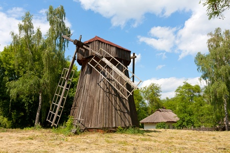 old windmill on meadow photo