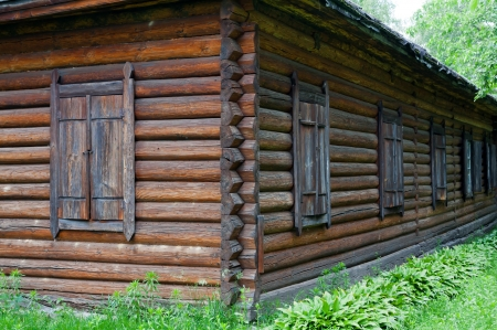 closed wooden windows of old rural house photo