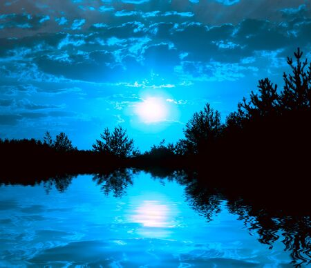 night scene on lake with moonlight photo