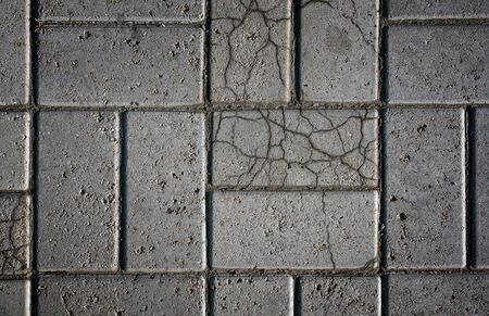 Tiled mosaic concrete pavement of the road  photo