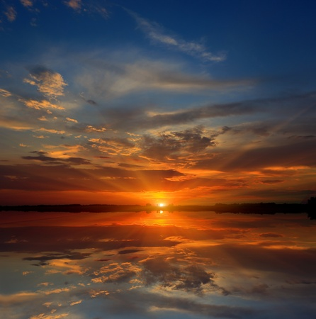 Nice sunset over lake water photo