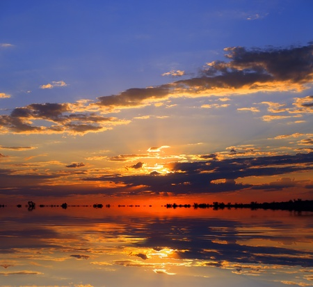 Nice sunset over lake water surface photo
