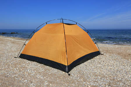camping tent: Yellow tourist tent on sea beach