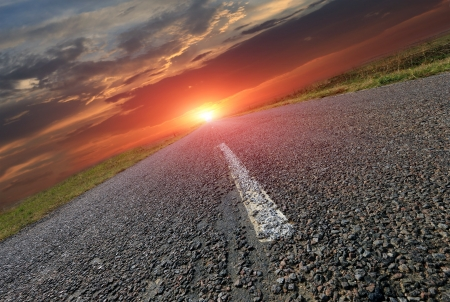 Asphalt road and hot sunset Stock Photo