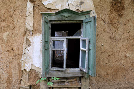 Old window of abandoned rural house photo