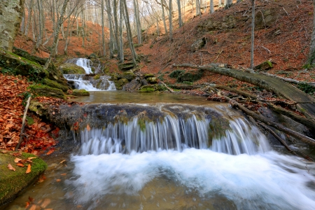 Cascade of mountain river in autumn forest  Take it Crimea photo