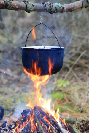 Tourist kettle on camp fire Stock Photo - 24961004