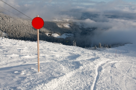 red round sign on winter ski resort photo