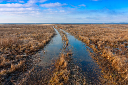 rut: flooded rut road in steppe Stock Photo