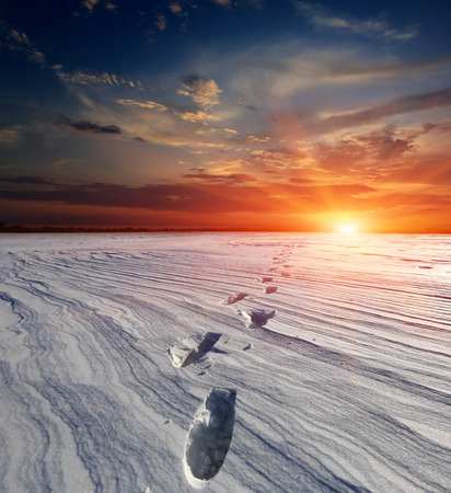 landscape with snow-path in steppe on sunset  photo