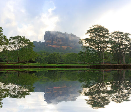 Sigiriya Castle in morning mist and clouds photo