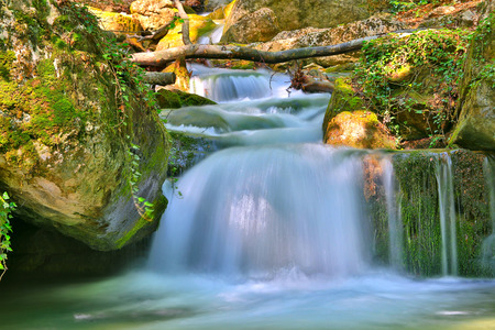 Landscape with Nice small waterfall on mountain river photo