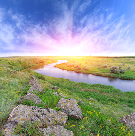 sunshine over river in steppe photo