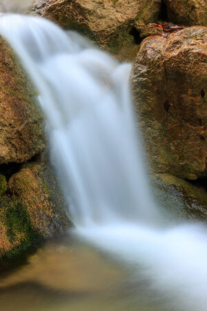 trickles: small waterfall on mountains river Stock Photo