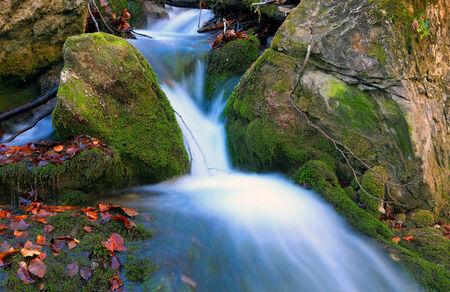 Nice cascade of mountain stream photo