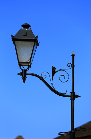 vintage street lantern over blue sky background photo