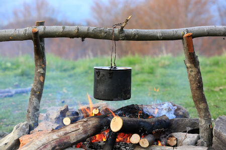 smoked tourist kettle over campfire photo