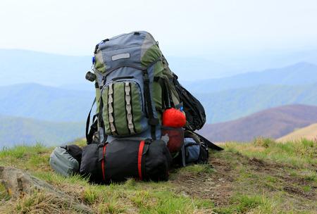 tourist equipment on mountain meadow Stock Photo