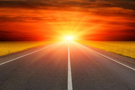 Empty asphalt road to sunset photo