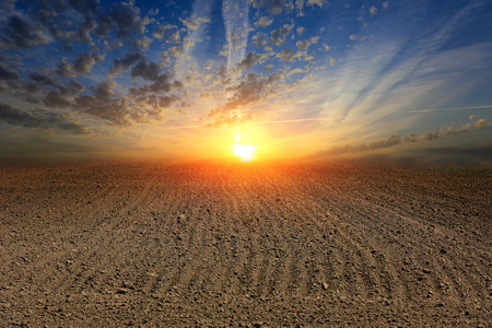 tillage: Hot sunset over ploughed field