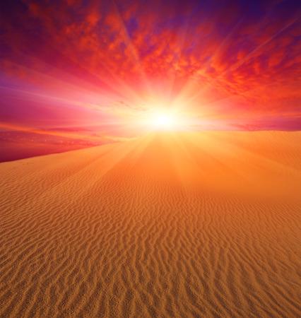 Sunset over sand dunes in deser Stock Photo