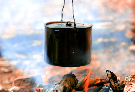 smoked tourist kettle over camp fire photo