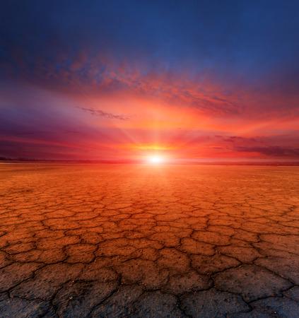 sunset scene over cracked earth Stock Photo