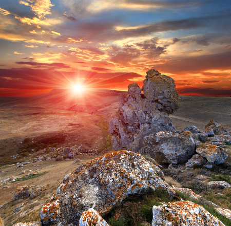 sunset with rocks in mountains Stock Photo