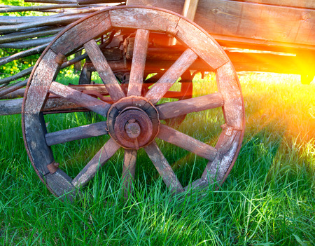 wheel of old wooden carriage photo