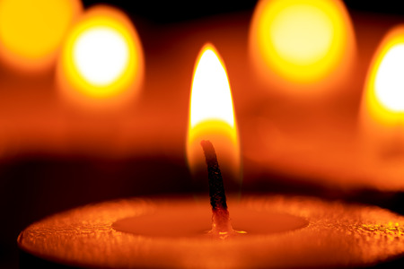 Bright flame of candle in darkness Stock Photo