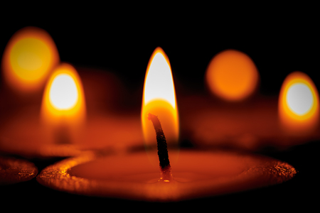 candle wick: Hot flames of candles in dark room