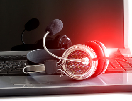 Abstract headphones on notebook keyboard Stock Photo