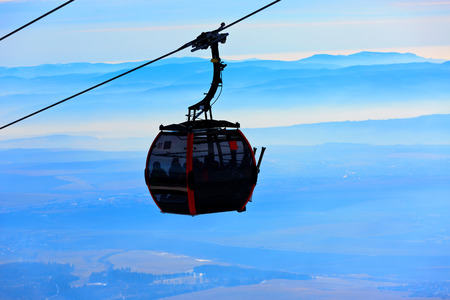 ski lift: Ski lift over clouds on winter resort Stock Photo