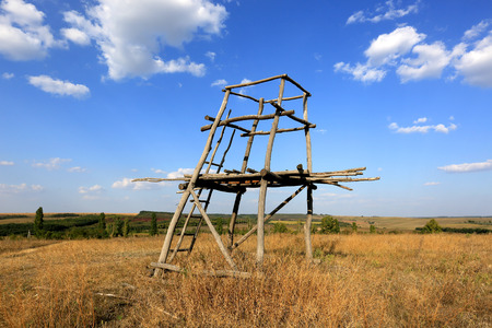 hunters tower: Wooden tower viewpoint in steppe Stock Photo