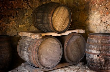 Barrel store in dark curing cellar photo