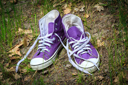 pair of gymshoes in green grass photo