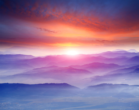 Nice sunset scene over misty mountains