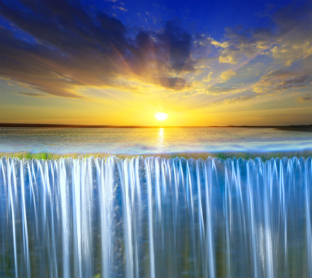 Scene with waterfall on sunset sky  Standard-Bild