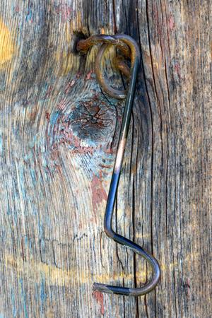old hook on wooden door photo