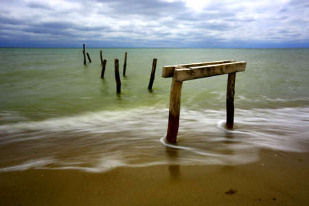 bridger: Old wooden bridger on sea coast Stock Photo