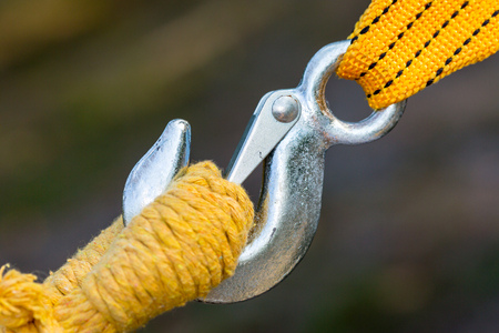 strap: Steel hook and yellow rope and strap