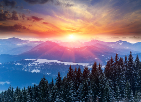 Winter scene with sunset in mountains