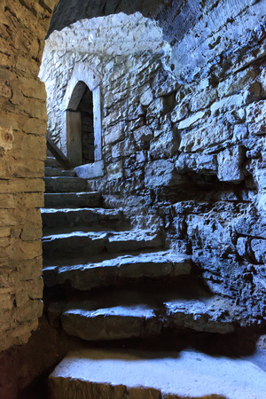 Stone arch and steps in underground castte