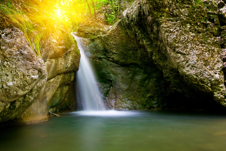 waterfall river: Nice landscape with waterfall on sunset background